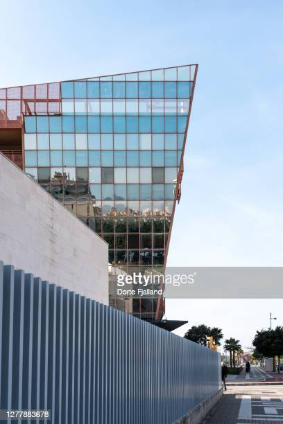 blue steel fence, white wall and a mirror glass facade along a sidewalk - dorte fjalland stock pictures, royalty-free photos & images