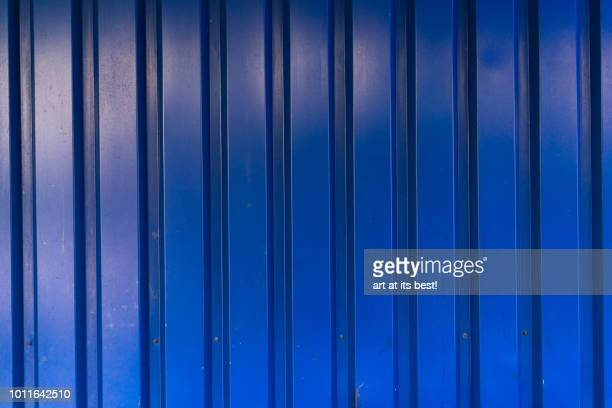 blue steel panel wall. - sheet metal stock pictures, royalty-free photos & images