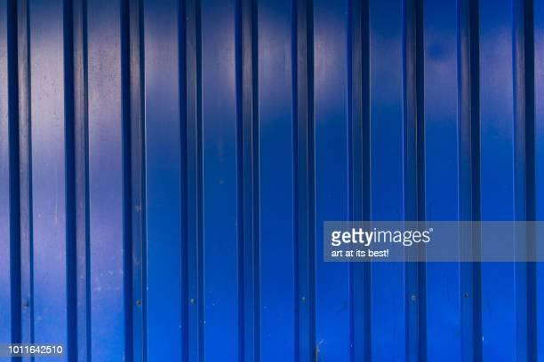 Blue steel panel wall.