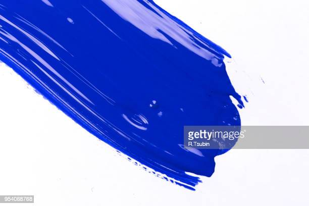 blue stroke of the paint brush on white paper - blob stock photos and pictures