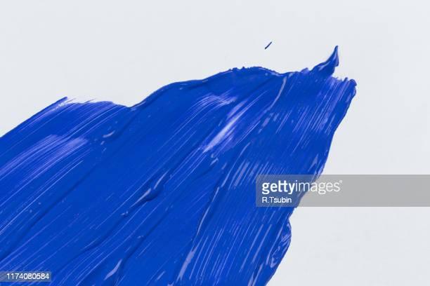 blue stroke of the paint brush on white paper sketch - canvas bildbanksfoton och bilder