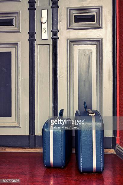 Blue Suitcases Outside House Door
