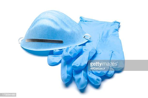 Blue surgical gloves and face mask on white background