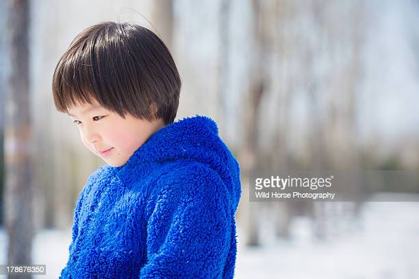 Blue sweater girl in the winter woods