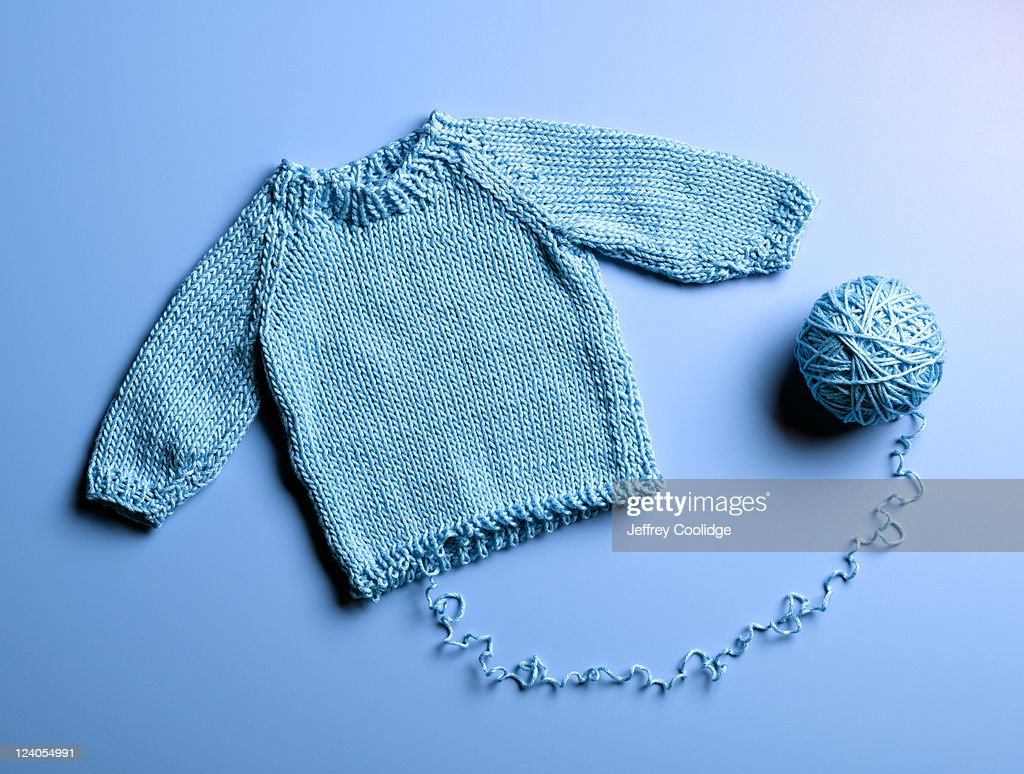 Blue Sweater Unraveling : Stock Photo