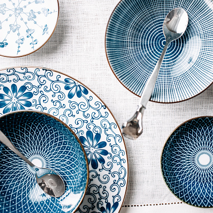 Blue table ware plates and bowls overhead 492986980