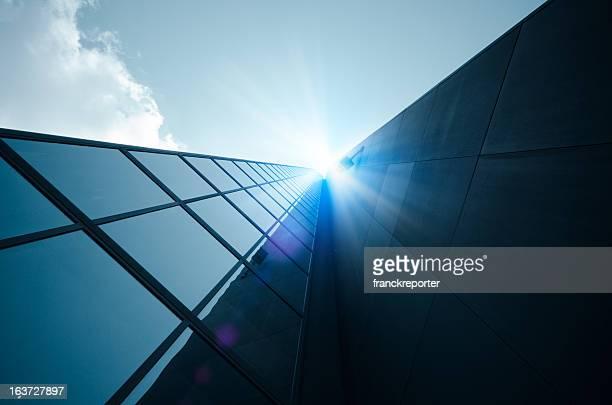 Blue tall Boston skyscraper against Sun