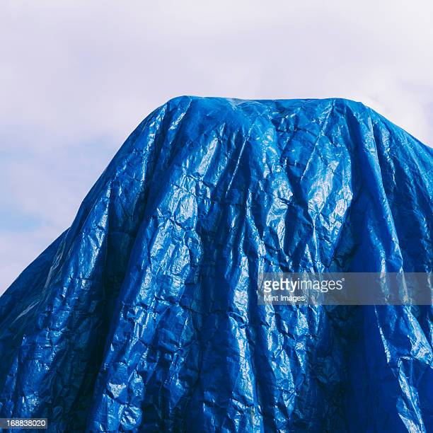 A blue tarpaulin, draped over commercial fishing nets, Fisherman's Terminal, Seattle