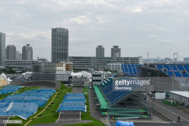 Blue tarps cover the courses in Ariake Urban Sports Park, the venue for BMX and skateboarding events at the Tokyo 2020 Olympic Games in Tokyo Japan,...
