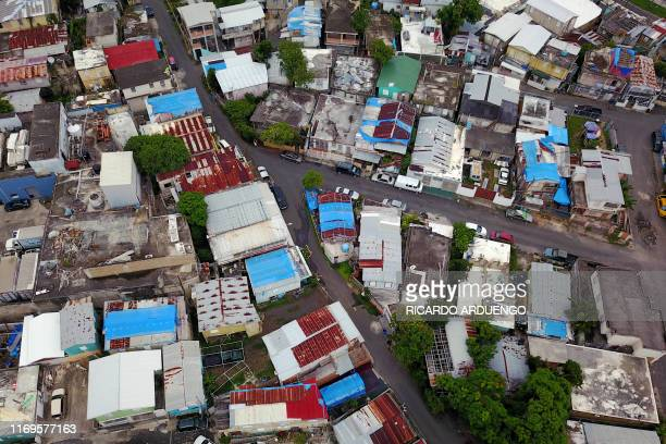 Blue tarps given out by FEMA cover several roofs two years after Hurricane Maria affected the island in San Juan, Puerto Rico, September 18, 2019. -...