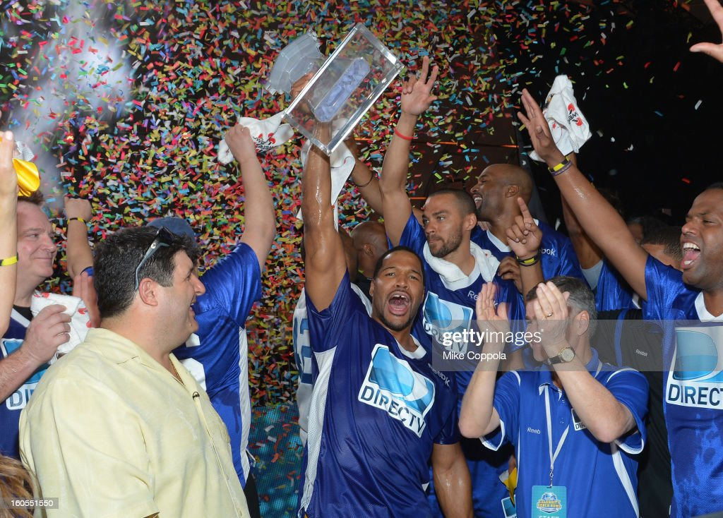 Blue Team Coach Michael Strahan (C) celebrates his team's win at DIRECTV'S Seventh Annual Celebrity Beach Bowl at DTV SuperFan Stadium at Mardi Gras World on February 2, 2013 in New Orleans, Louisiana.