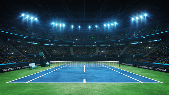 Blue tennis court and illuminated indoor arena with fans, upper front view 1176735816