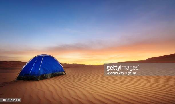 blue tent at desert against sky during sunset - tent stock pictures, royalty-free photos & images