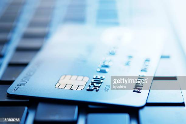 Blue tinted image of credit card on laptop
