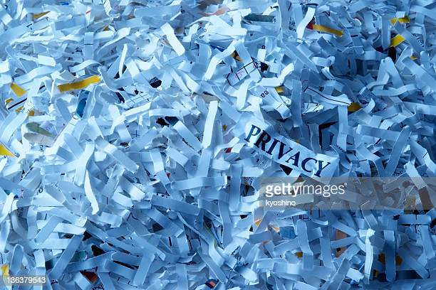 Blue tinted image of shredded privacy documents