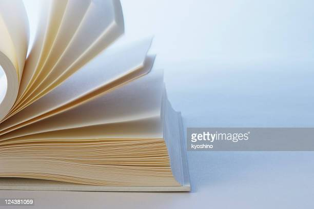 Blue tinted image of turning pages of a blank book