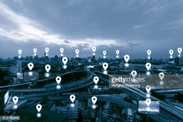 blue tone city scape and network connection concept , map pin business district - karte navigationsinstrument stock-fotos und bilder