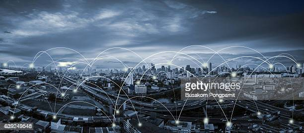 blue tone city scape and network connection concept - atomic imagery 個照片及圖片檔