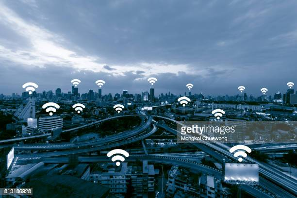 Blue tone cityscape and network connection concept , Wifi Wireless business district