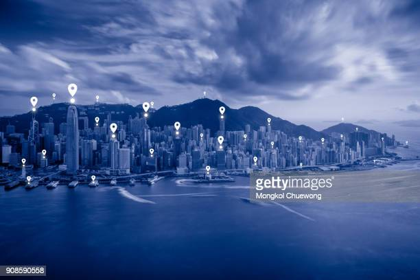 Blue tone Hong Kong cityscape view form sky 100 Hongkong and network connection concept , Map pin business district