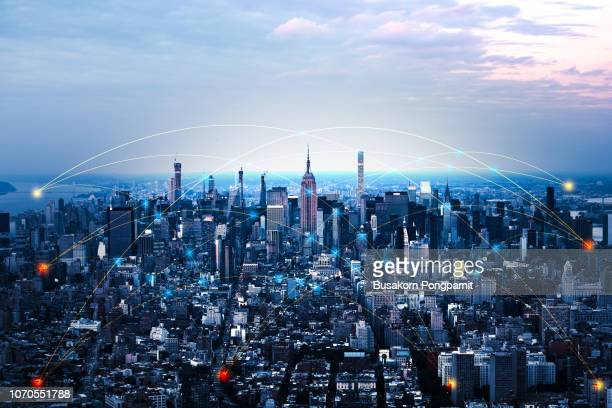 blue tone network and connection technology concept with city background. at new york - connection stock pictures, royalty-free photos & images