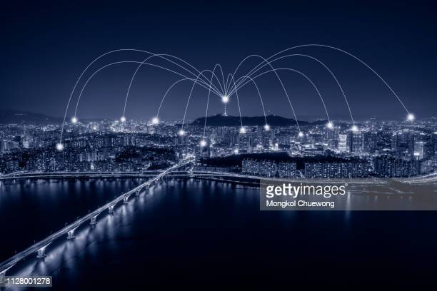 blue tone seoul downtown city skyline with network connection concept, night view of bridge cross over han river from yeouido business district into n seoul tower at seoul city in south korea - transfer image stock pictures, royalty-free photos & images