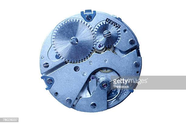 blue toned still life of a spherical metal gear, lying on a white background. - thinkstock stock-fotos und bilder