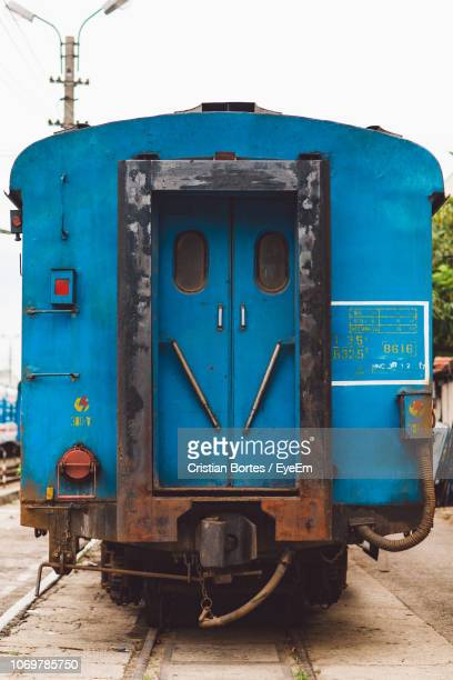 blue train against clear sky - bortes stock photos and pictures