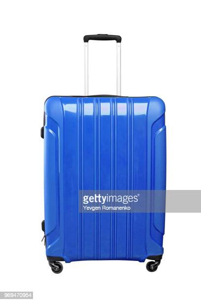 blue travel bag on wheels, isolated on white background. - bolsa objeto fabricado fotografías e imágenes de stock