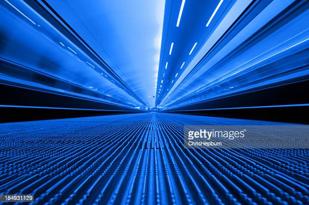 blue travelator - manchester international airport stock pictures, royalty-free photos & images