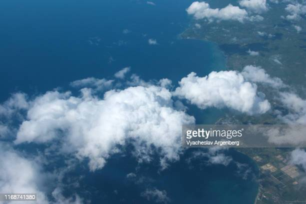 blue tropical sky with white clouds, aerial panoramic view of palawan near puerto princesa - argenberg stock pictures, royalty-free photos & images