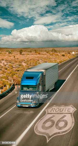 Blue truck driving through Southwest USA on route 66