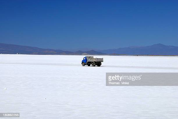 Blue truck driving to the salt mining on the salt pan, Salinas Grandes, 4000 m, Province of Jujuy, Andes, Argentina, South America