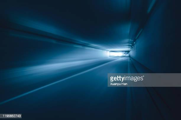 blue tunnel at night - light at the end of the tunnel stock pictures, royalty-free photos & images