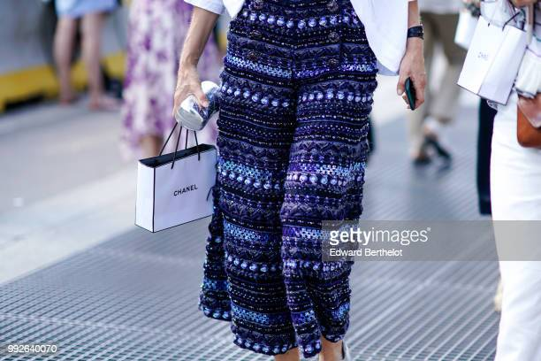 A blue tweed dress outside Chanel during Paris Fashion Week Haute Couture Fall Winter 2018/2019 on July 3 2018 in Paris France