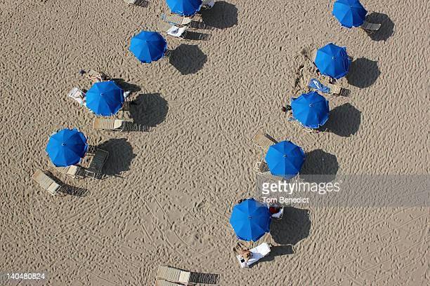 blue umbrellas - hapuna beach stock photos and pictures