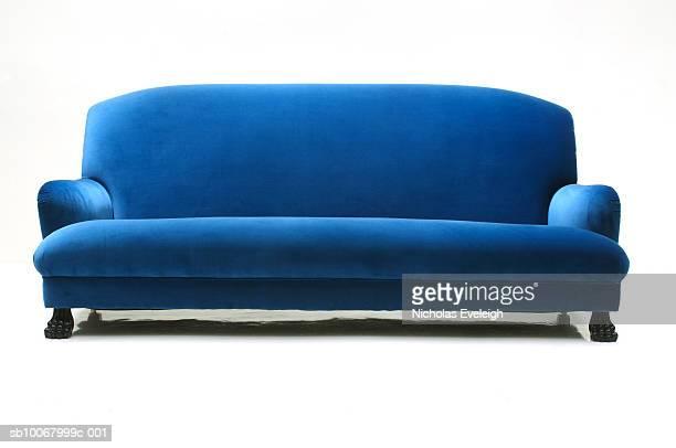 Blue velvet sofa on white background