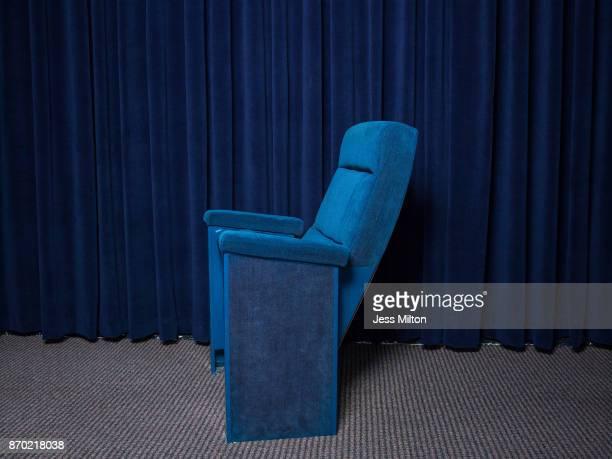 Blue velvet theater chair with blue velvet curtain