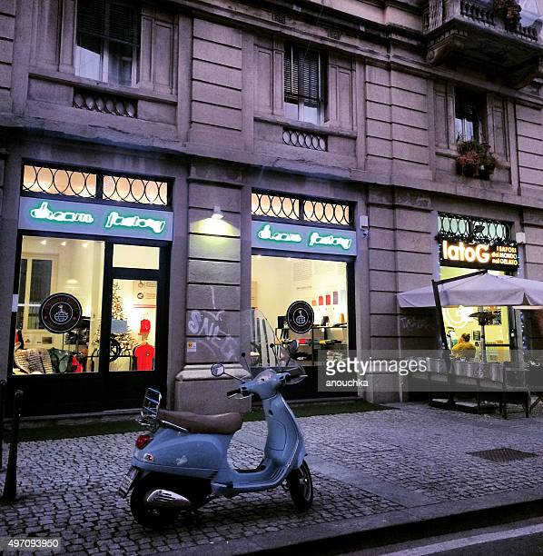 blue vespa parked on milan street - vespa brand name stock pictures, royalty-free photos & images