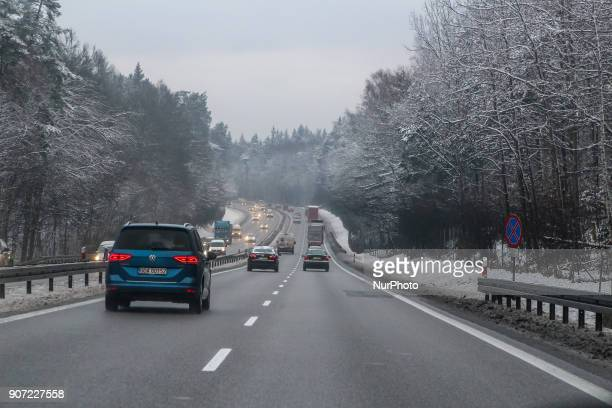 Blue Volkswagen Touran in the winter scenery of the Tricity Ringroad is seen in Gdansk Poland on 19 January 2018 Heavy snow fall and wind Power has...