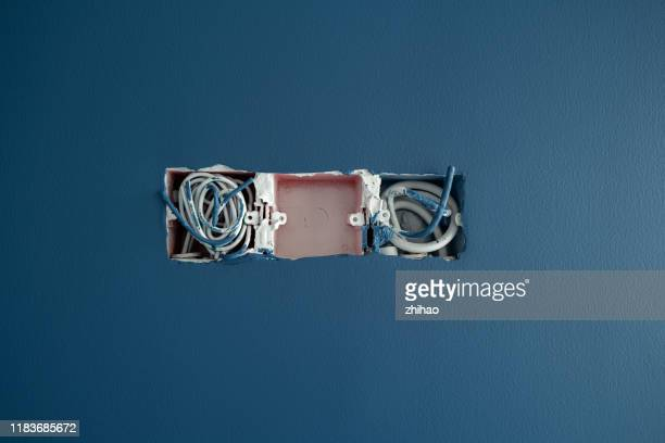 blue wall, electrical switch slot waiting for construction - electrical box stock pictures, royalty-free photos & images