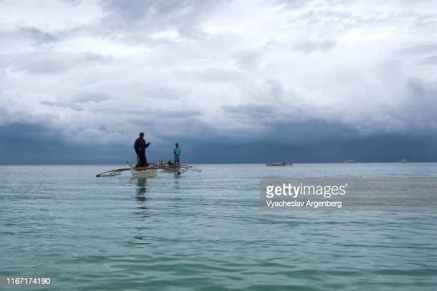 blue water and heavy tornado sky, tropical clouds over visayan sea, ethereal atmospheric conditions, tension intensification, complete silence, philippines - argenberg fotografías e imágenes de stock