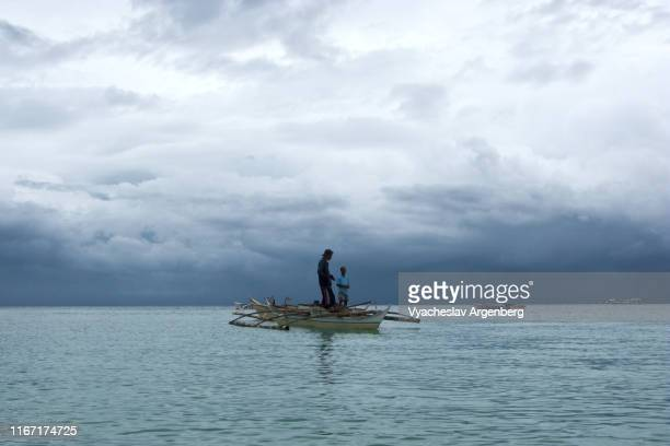blue water and heavy tornado sky, tropical clouds over visayan sea, ethereal atmospheric conditions, philippines - argenberg fotografías e imágenes de stock