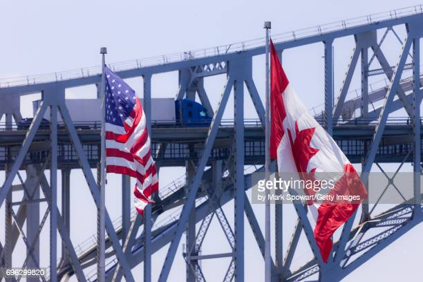 blue water bridge - national border stock pictures, royalty-free photos & images