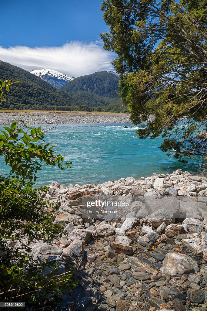 Blue water of Makarora River in New Zealand : Stock Photo