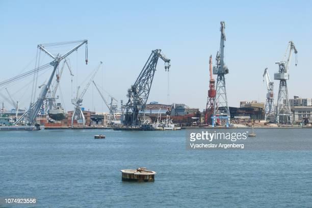 blue waters of suez canal, port fuad, egypt - argenberg stock-fotos und bilder
