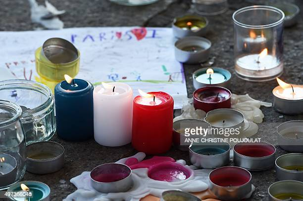 Blue white and red candles burn within a minute of silence on November 16 2015 on the old Harbour in Marseille to pay tribute to victims of the...
