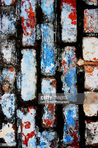blue, white and red painted brick wall - lucy shires stock pictures, royalty-free photos & images