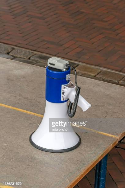 blue white megaphone - megaphone icon stock photos and pictures