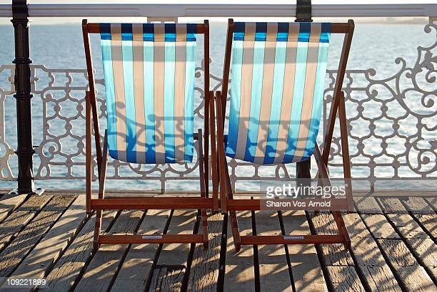 Blue & White Striped Deckchairs on a Pier